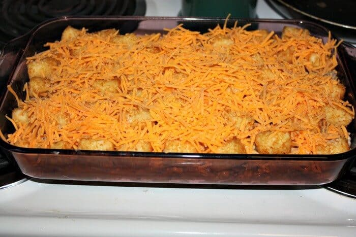 A super easy cowboy casserole recipe. Dinner recipe with cheddar cheese and tater tots.