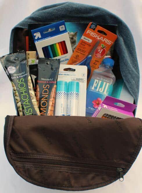 giving back pack stuffed back pack