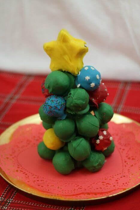 OREO Cookie Balls look so preet stacked as a Christmas tree with a star on top