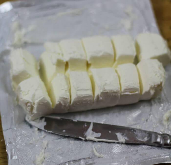 Oreo Cookie Balls cut cream cheese into chunks to make stirring easier