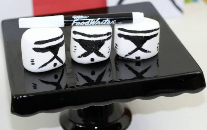 Use a Wilton food writer marker to draw storm trooper masks on Jumbo marshmallows