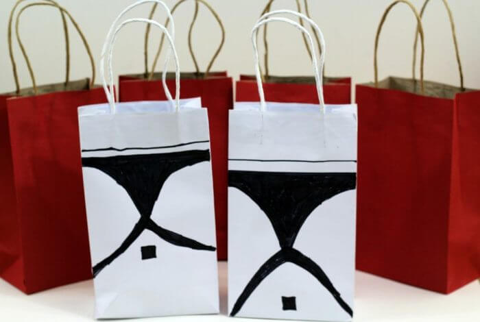 You can make storm trooper party favor bags by drawing a storm trooper mask with black marker onto a white bag.