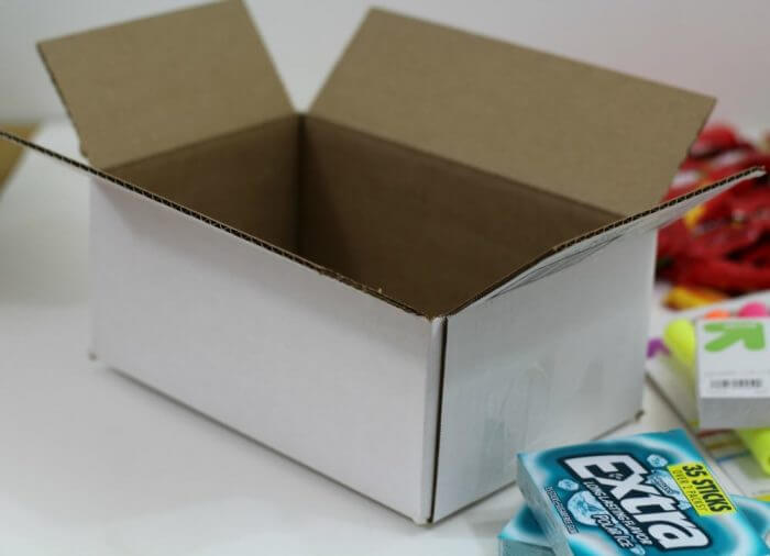 Start with a box. Pick the size baased on the amount of things you want to send. You want the box to be full so that there is not a whole lot of room for items to move around during shipping.